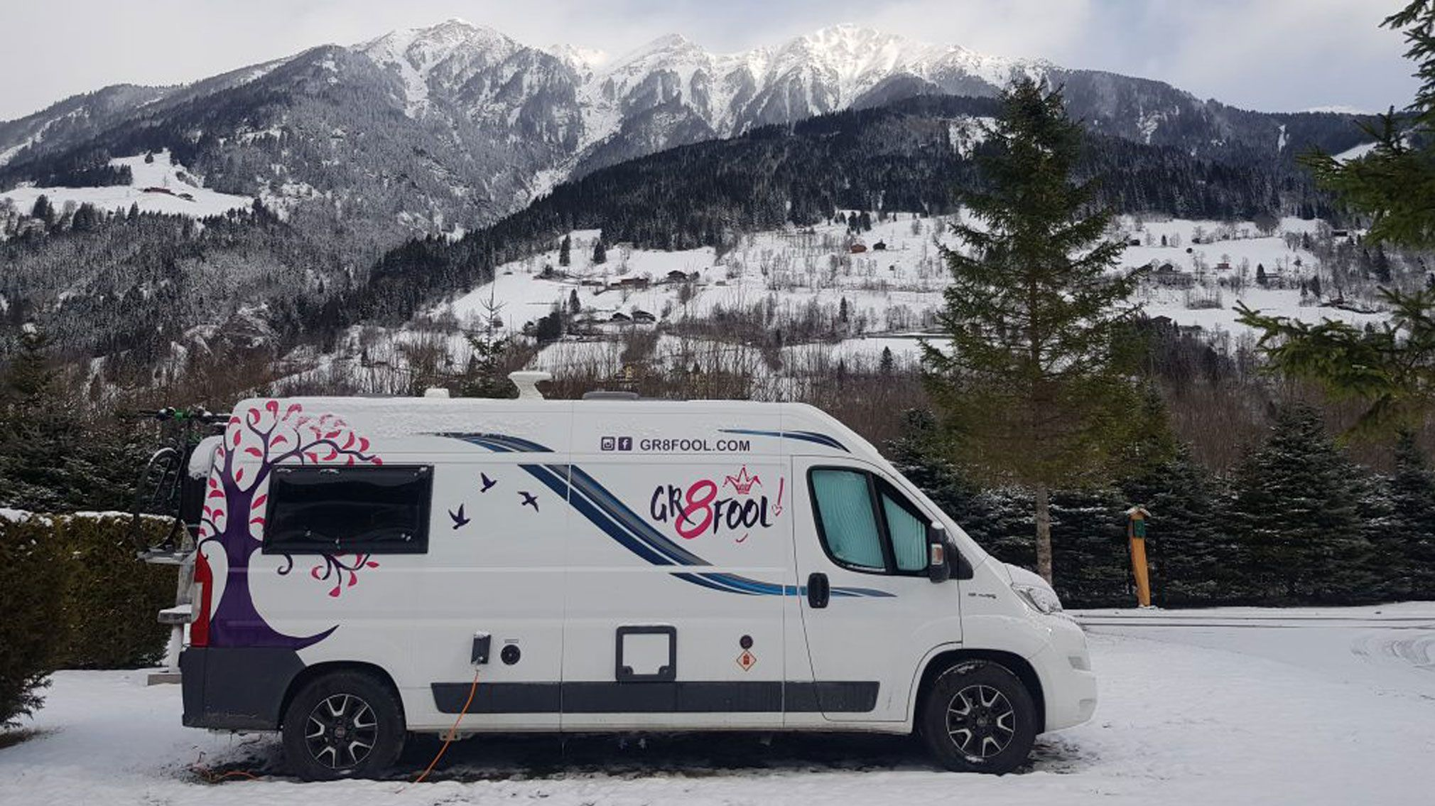 Compass Avantgarde campervan with a mountain range backdrop
