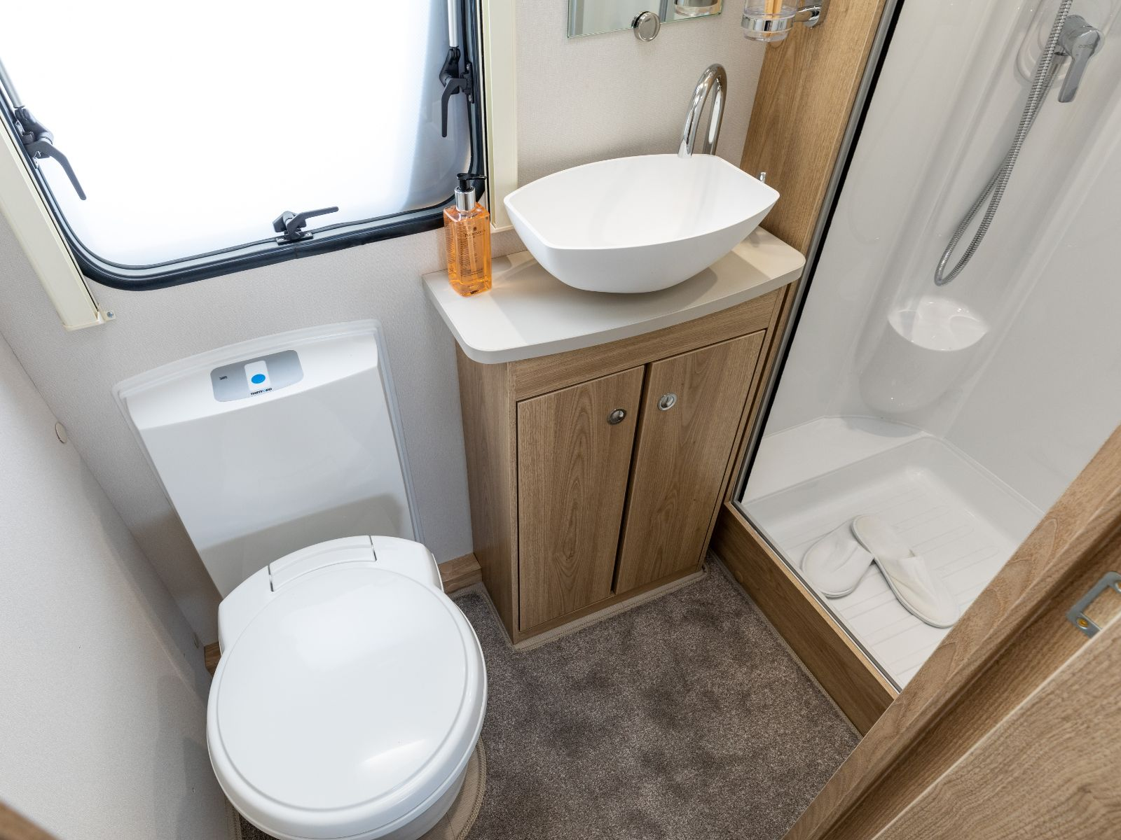 Bathroom layout with shower, sink and toilet'