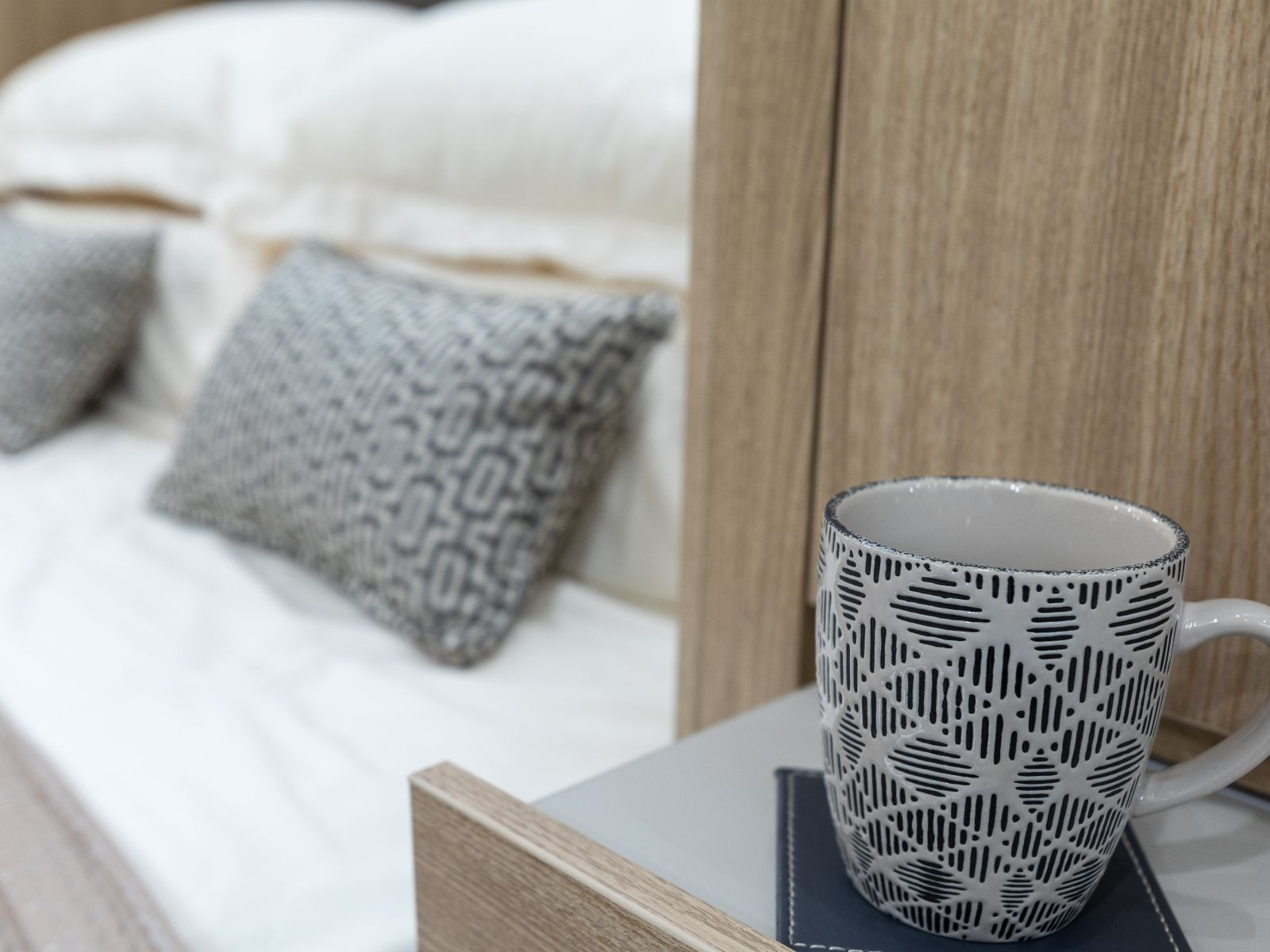 Coffee cup on bedside table'
