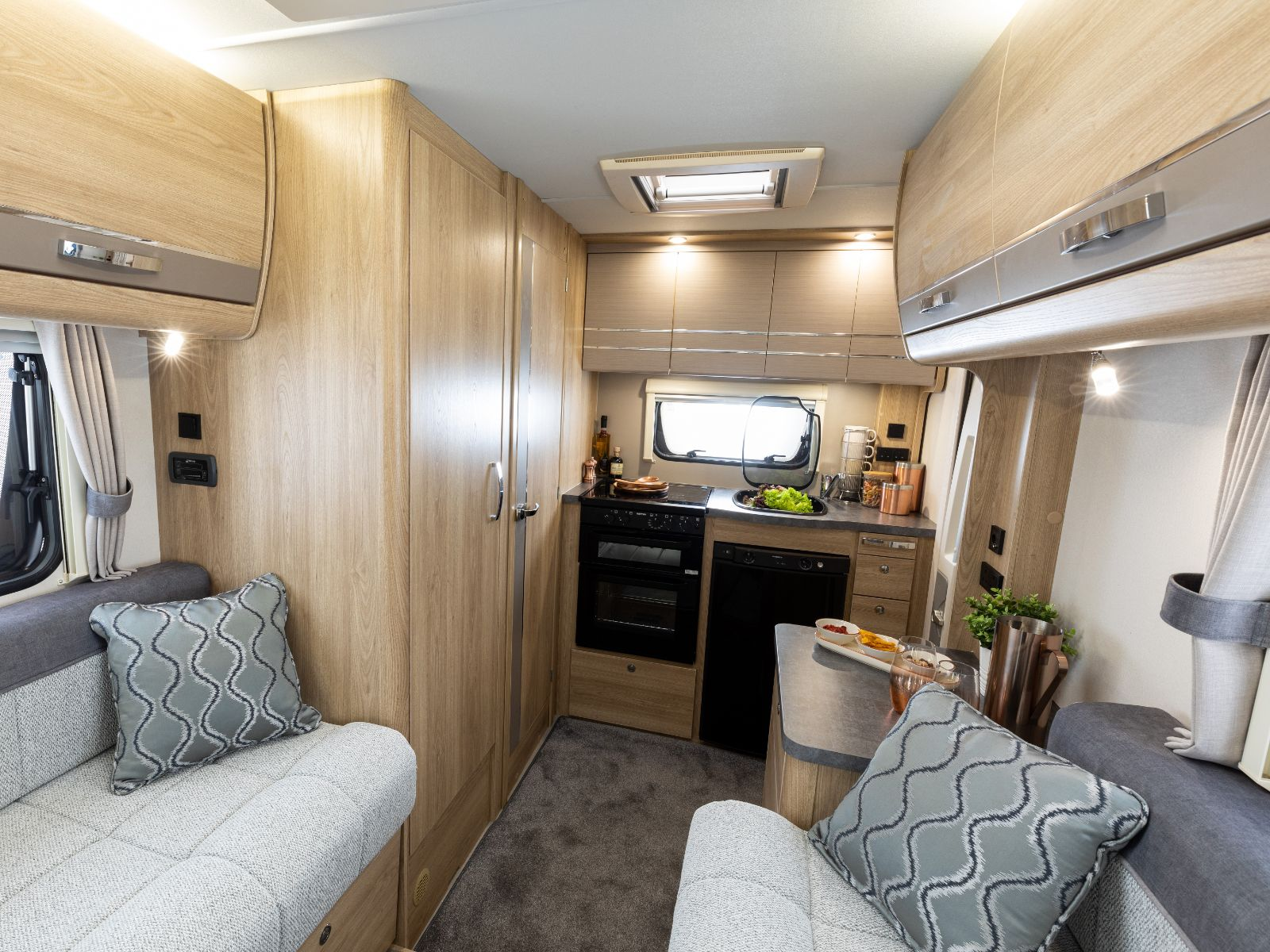 Lounge and kitchen area in the Autoquest 115'