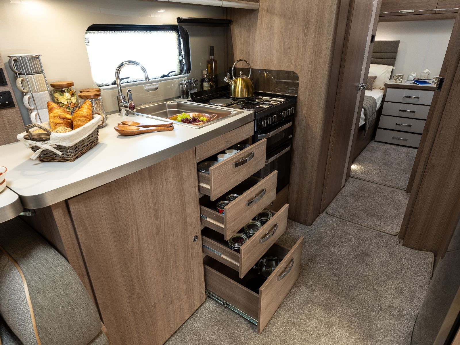 Kitchen layout with oven and under sink storage'