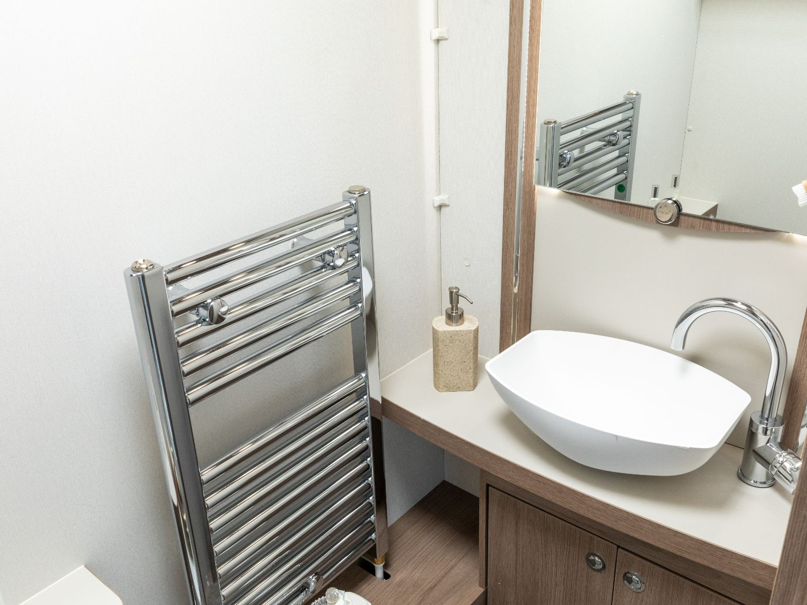 Bathroom sink, mirror and heated towel rack'