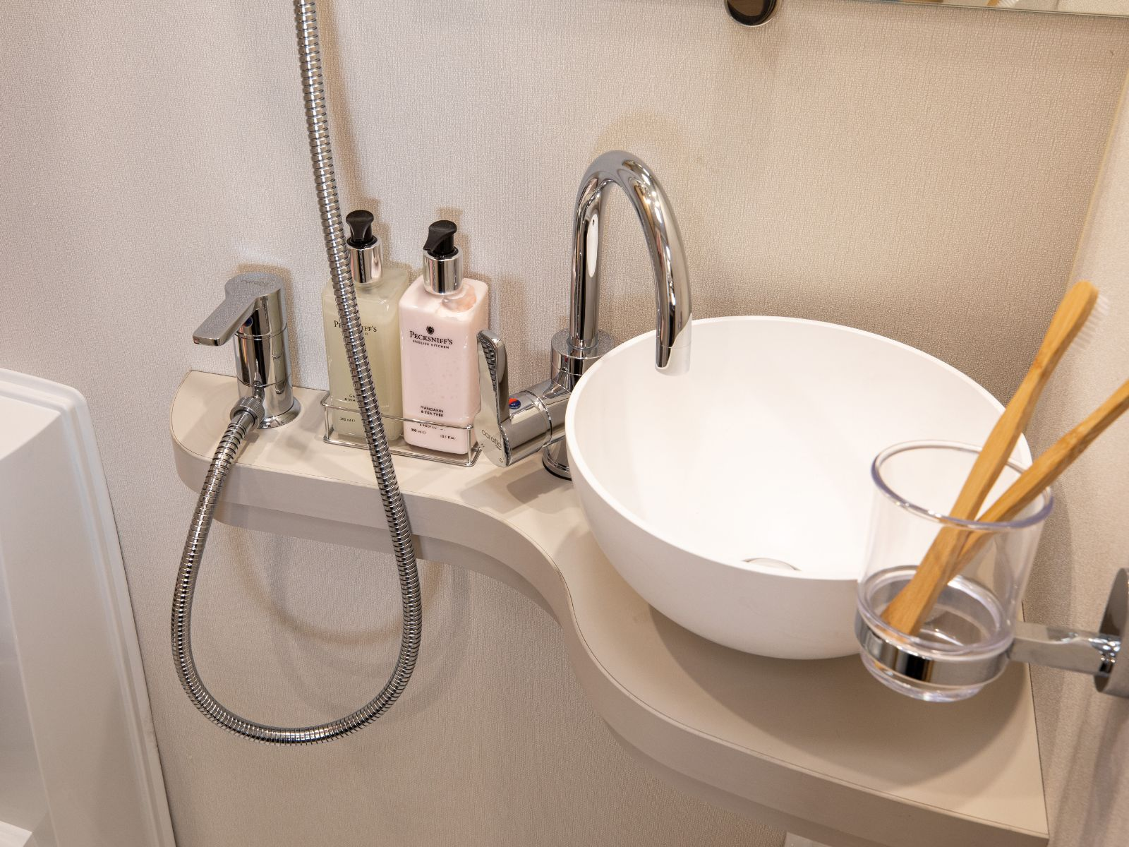 Bathroom sink with shower controls'