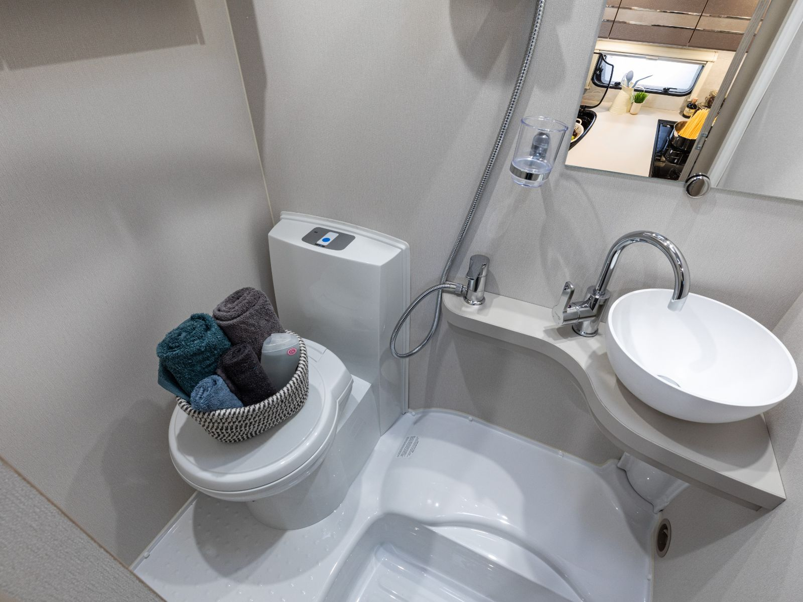 Bathroom layout with sink and toilet featuring toiletries'