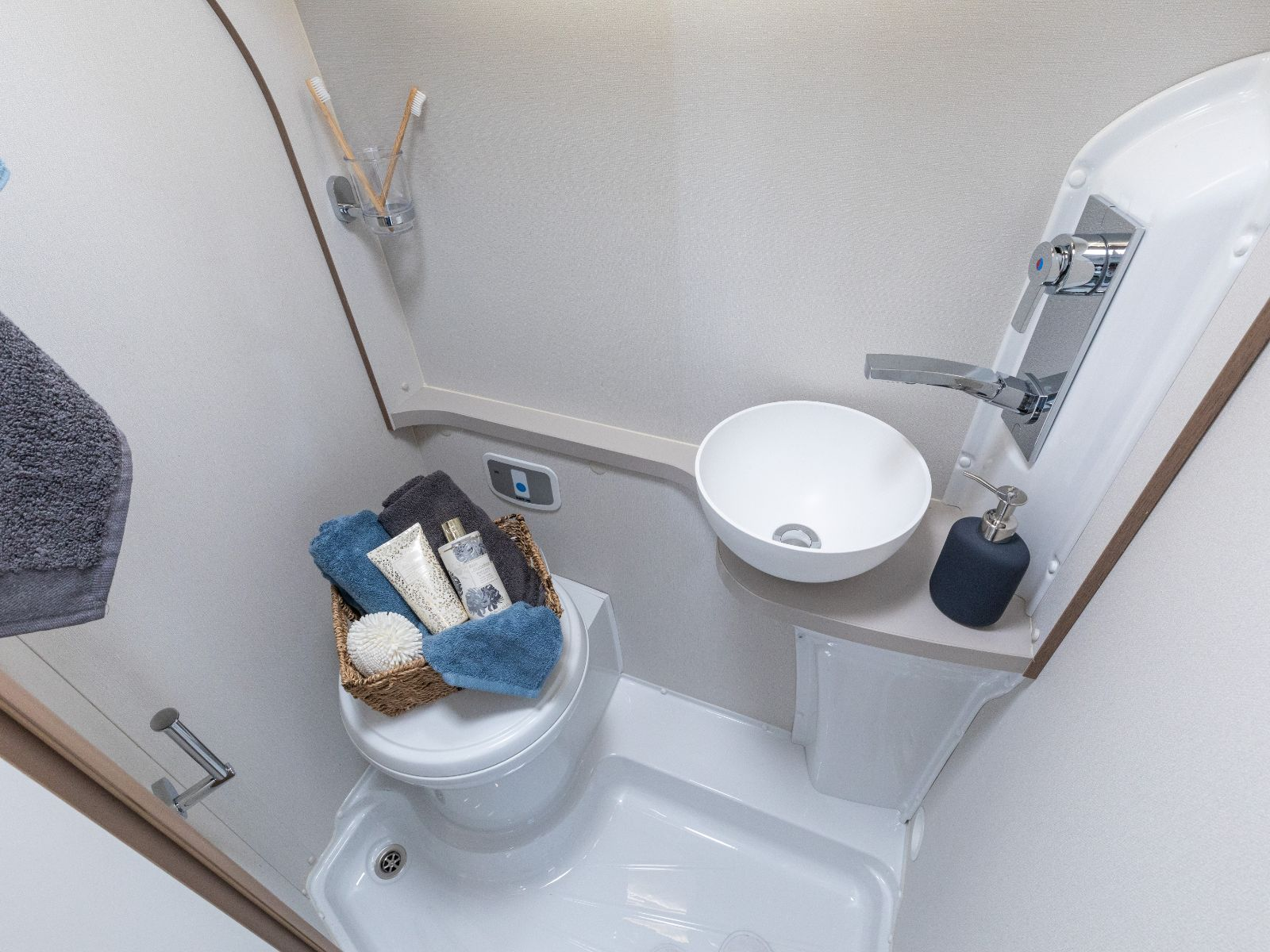 Bathroom layout with toilet, sink and shower controls'