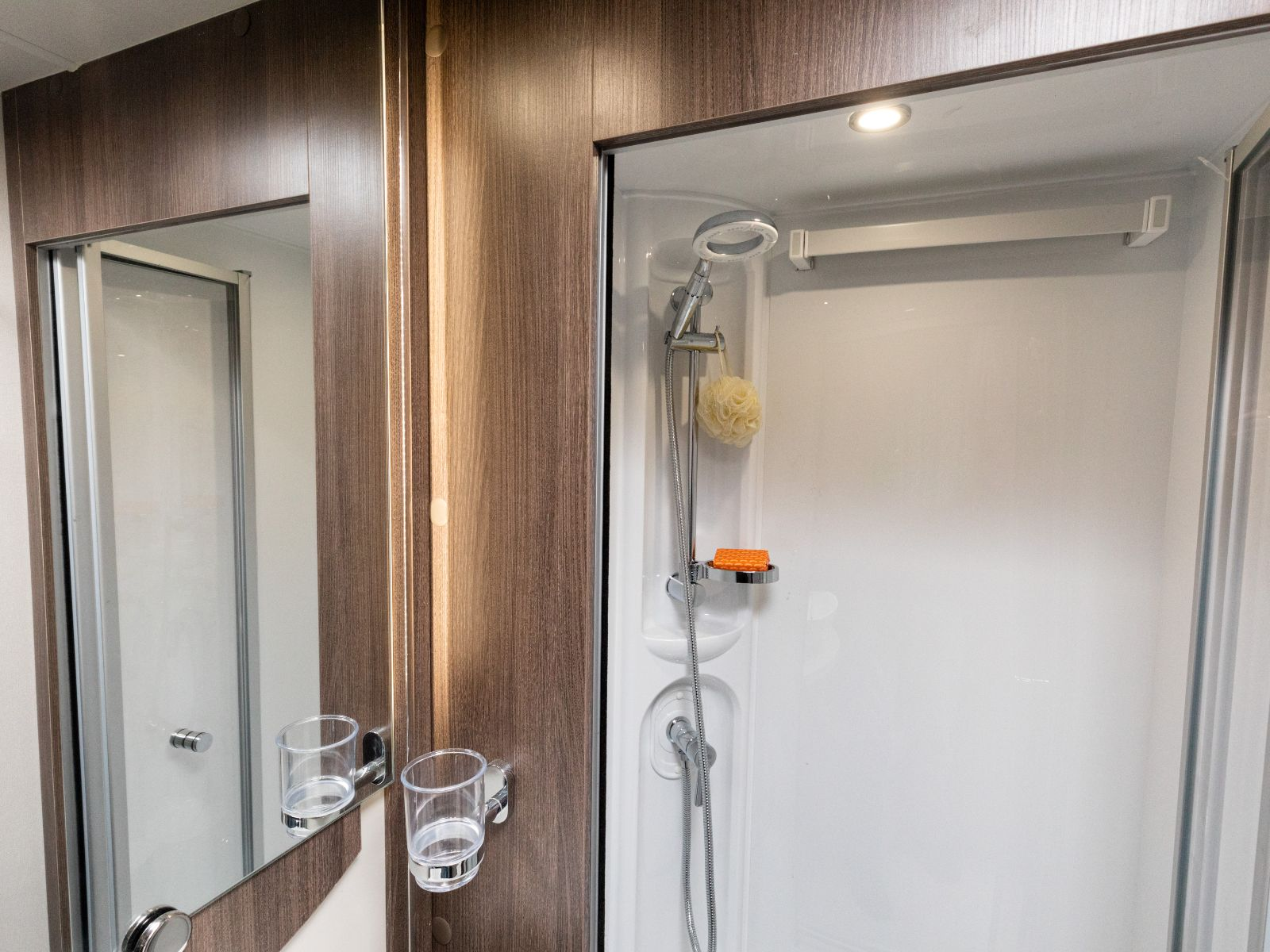 Bathroom shower layout with sliding glass panel doors'
