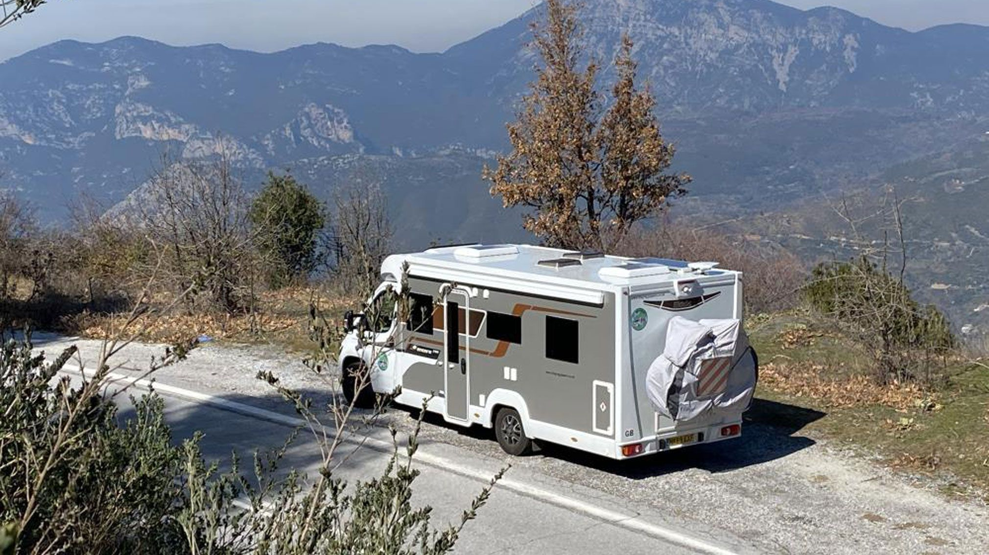 Elddis Encore 250 with a mountain range backdrop