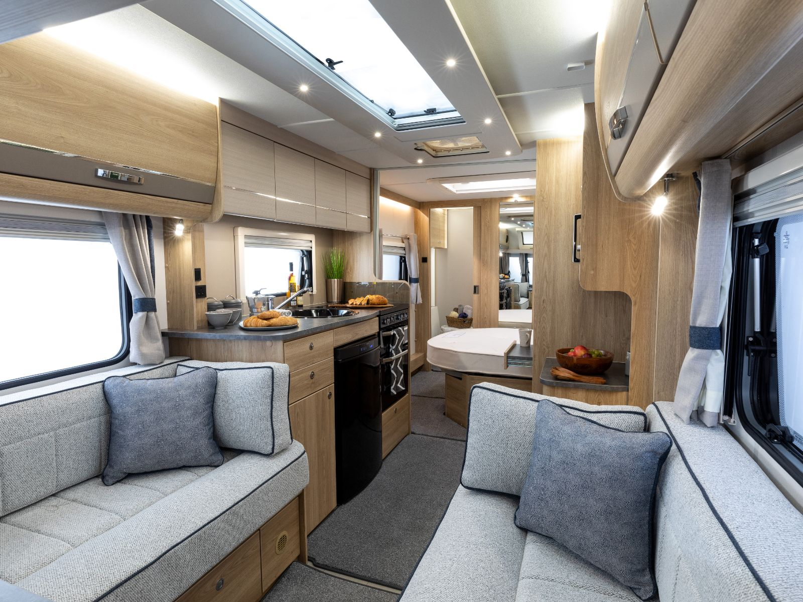 Chatsworth Caravan Lounge Area with Kitchen and Bedroom View'