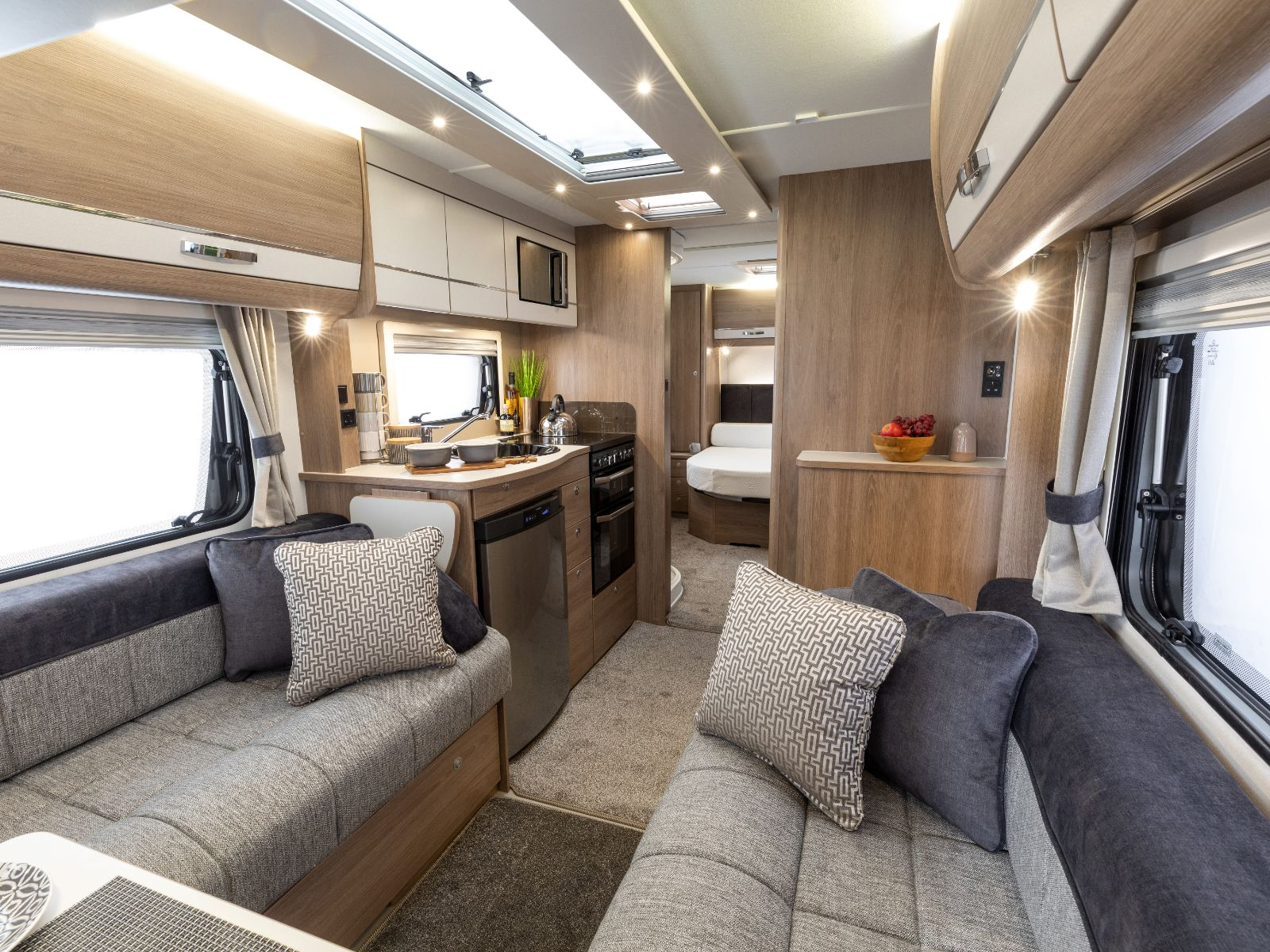 Kensington Caravan Lounge Area with Kitchen and Bedroom View'