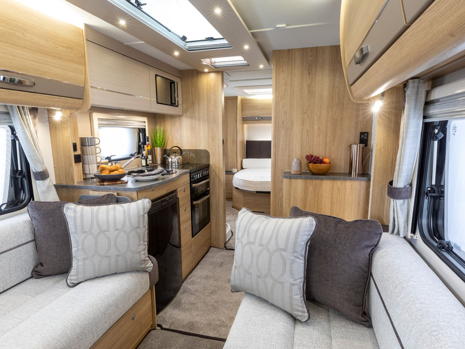 Riva Caravan Lounge Area with Kitchen View'