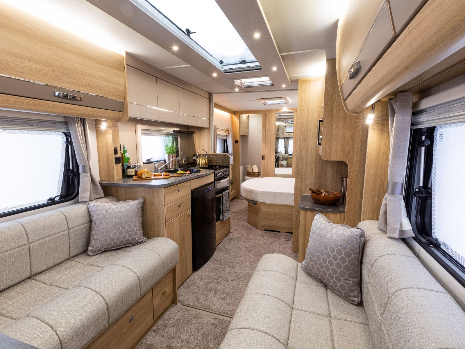 Sherwood Caravans Lounge Area with Kitchen and Bedroom View Featuring Double Bed'