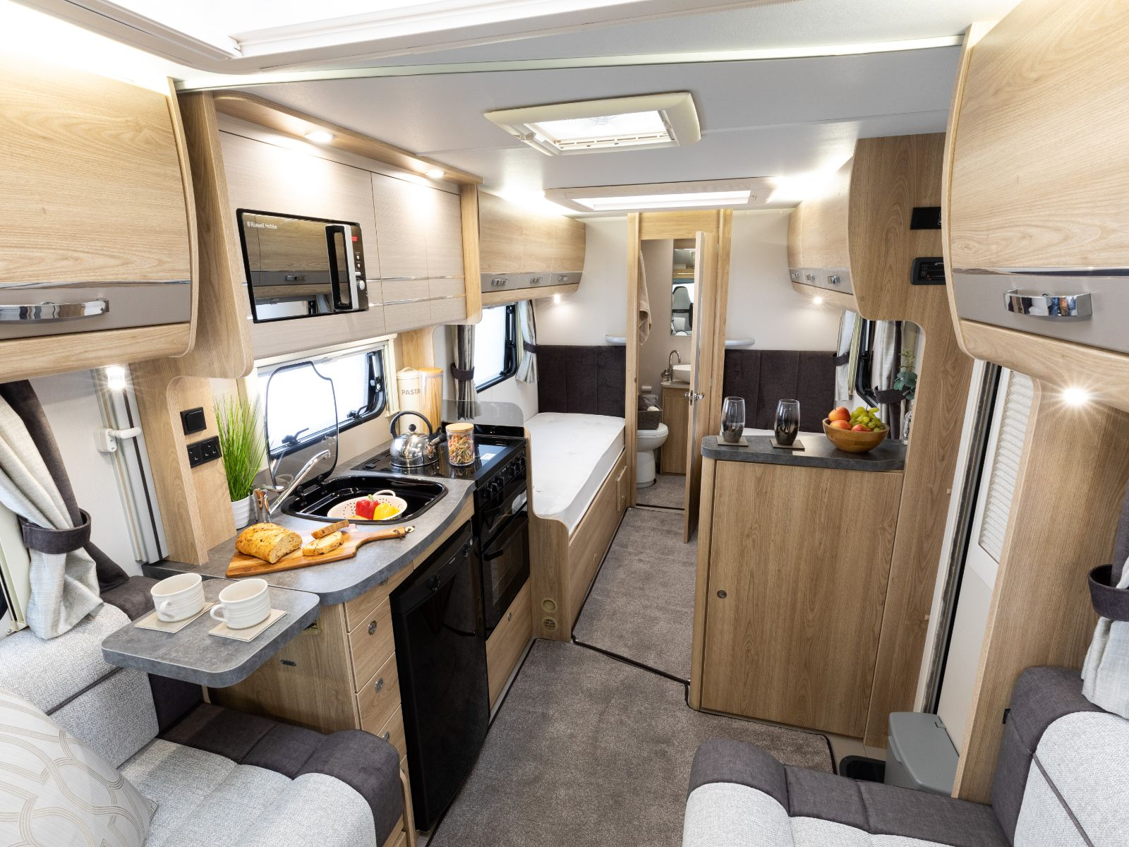 Riva Gold Motorhome Kitchen Area with Bedroom View Featuring Two Single Beds'
