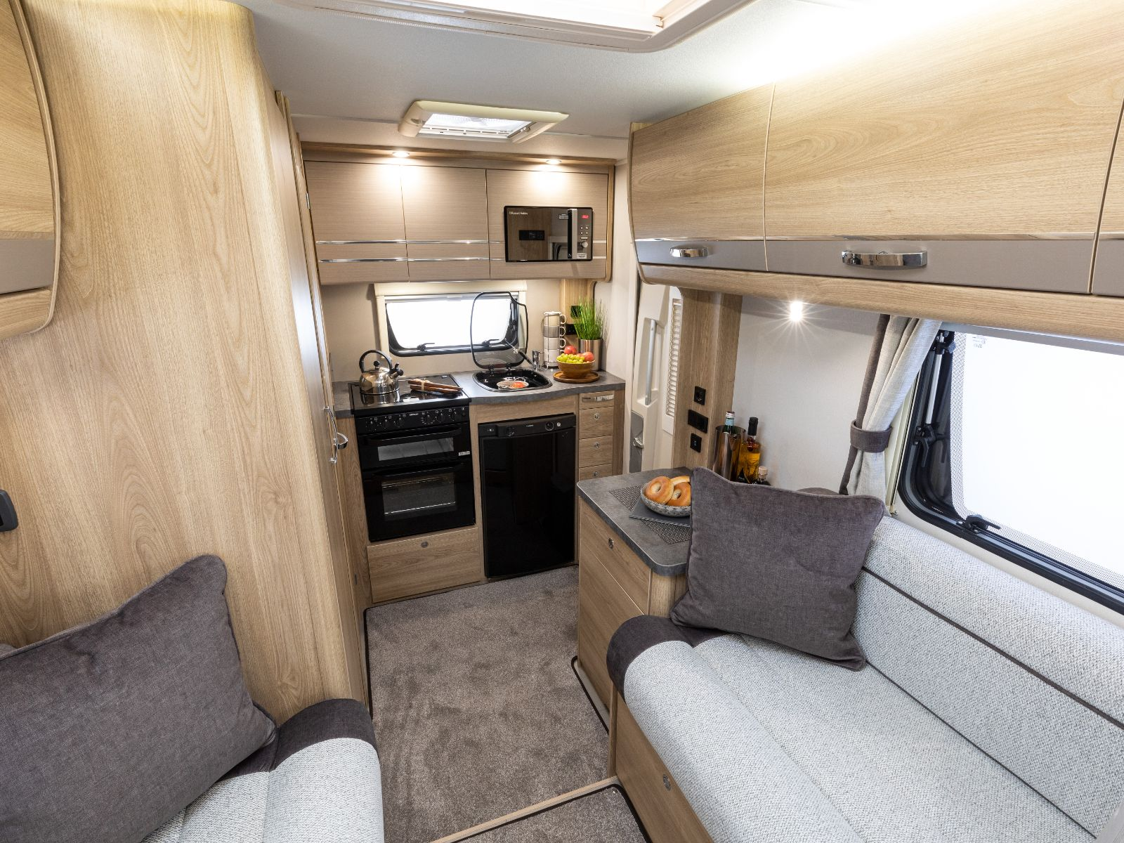 Riva Gold Motorhome Lounge Area with Rear Kitchen View'