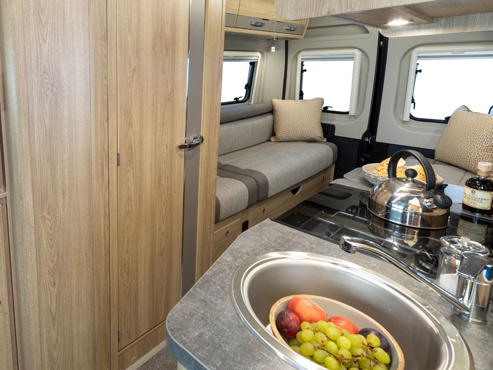 Evolution Campervan Kitchen and Lounge Layout'