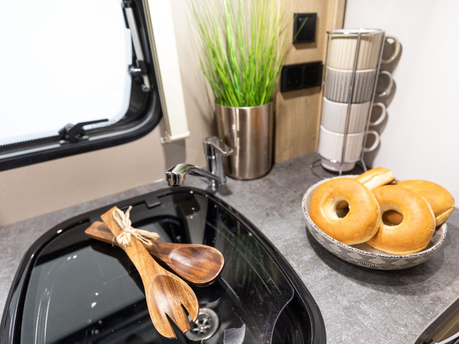 Bowl of Bagels and Kitchen Utensils on Kitchen Counter'
