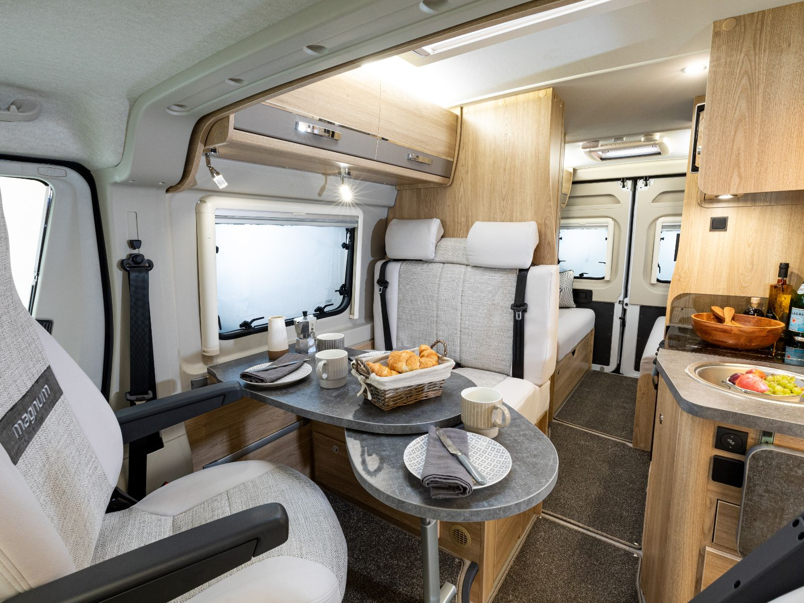 Magnum GTV Campervan Passenger View of Dining and Kitchen Area'