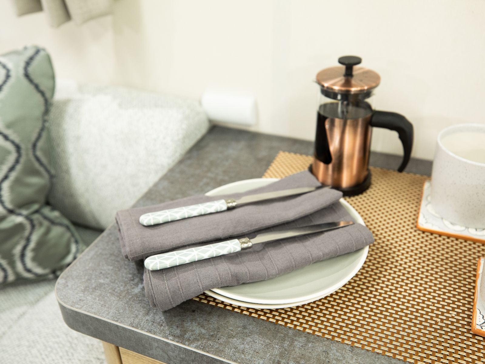 Cutlery and cafetiere on side table'