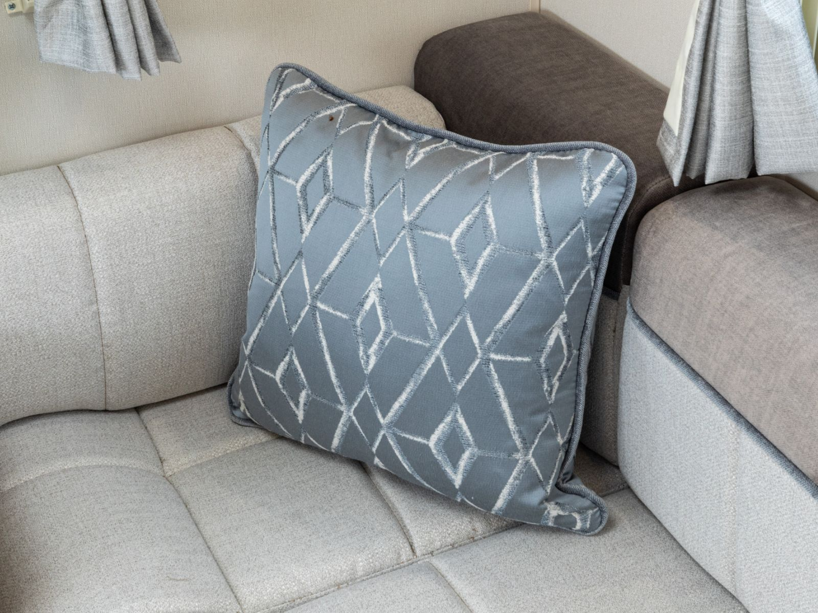 ActivCare upholstered sofa decorated with cushions'