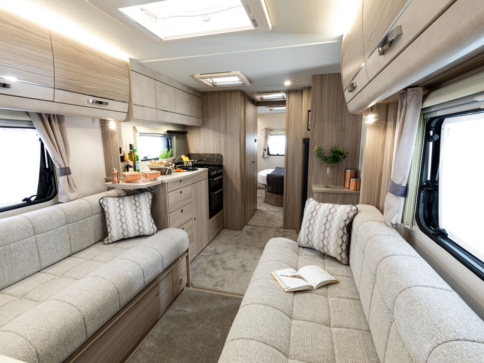 view into 860 caravan from front lounge with view of kitchen and bedroom '