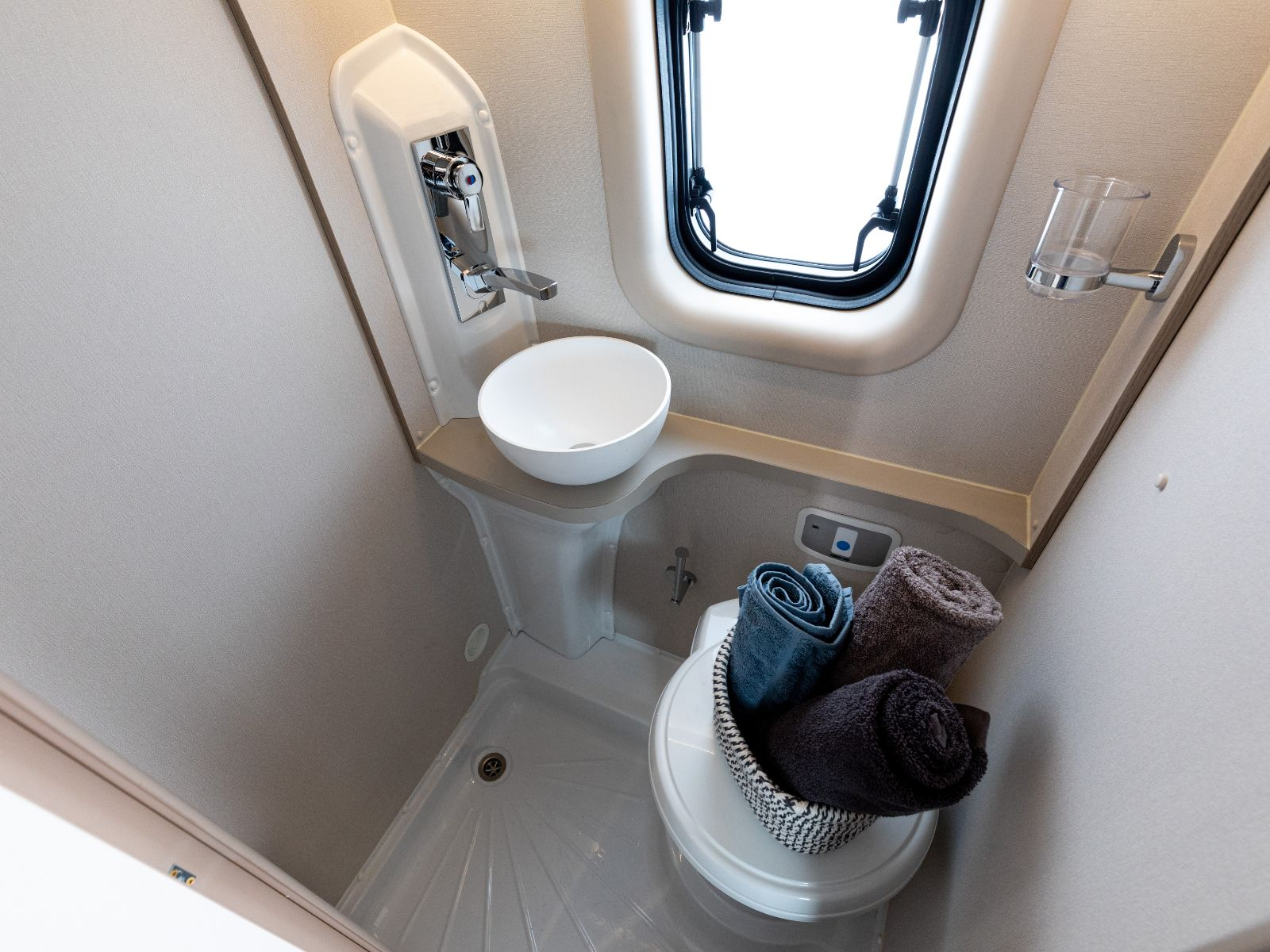 Bathroom with shower, toilet and sink '
