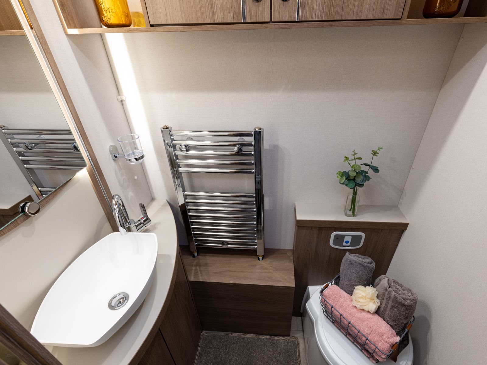 Toilet with towels and bathroom sink '