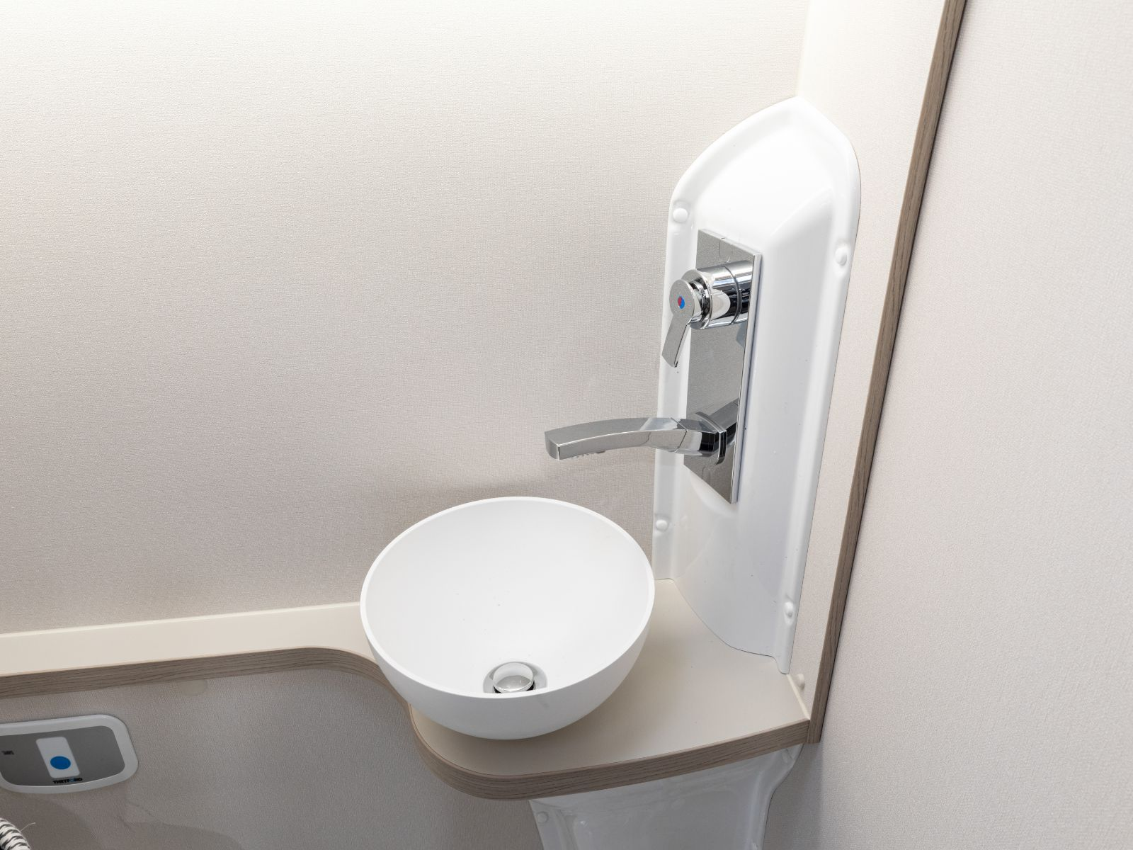 Bathroom sink and shower controls '