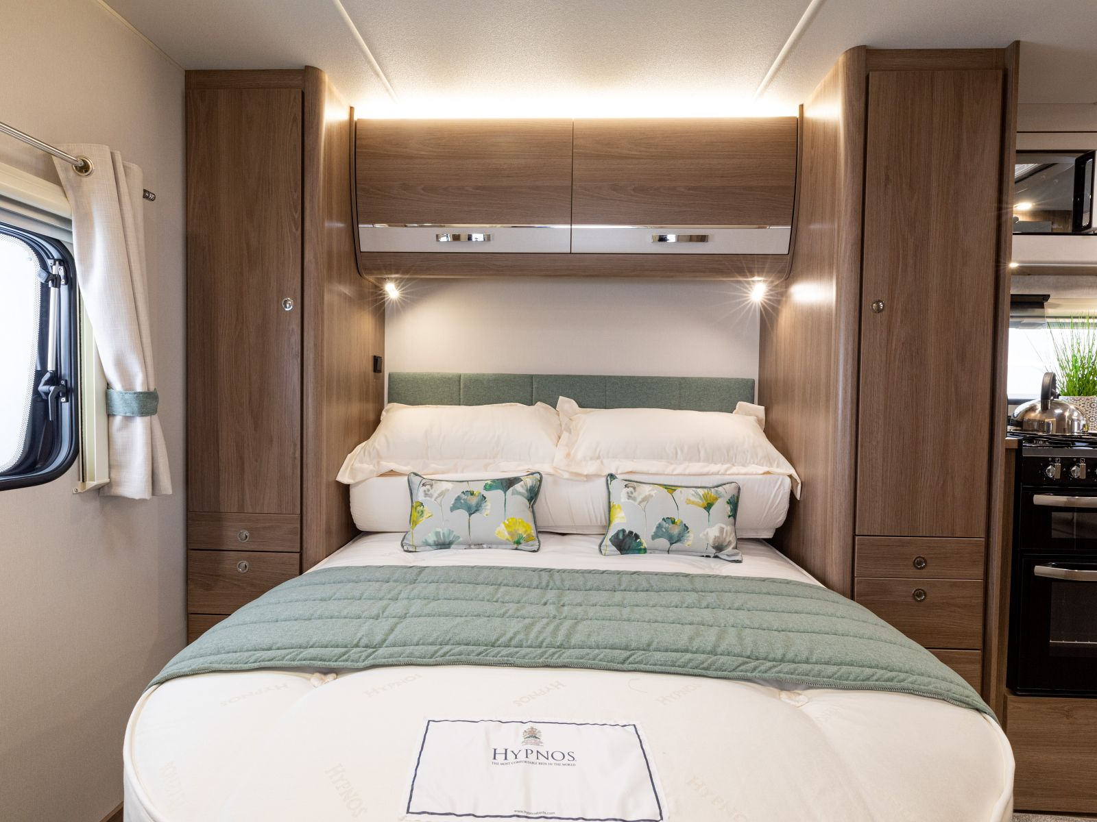 Double bed flanked by two large wardrobes '