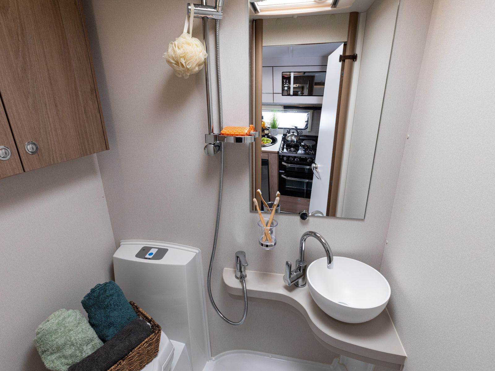bathroom with large mirror, sink and toilet '