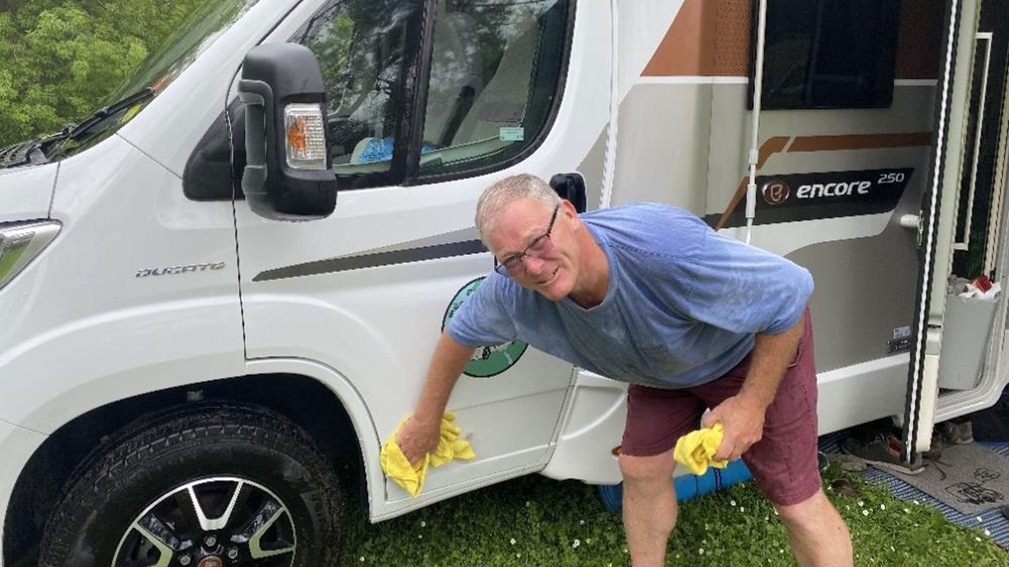 David of The Grey Gappers cleaning their Encore Motorhome