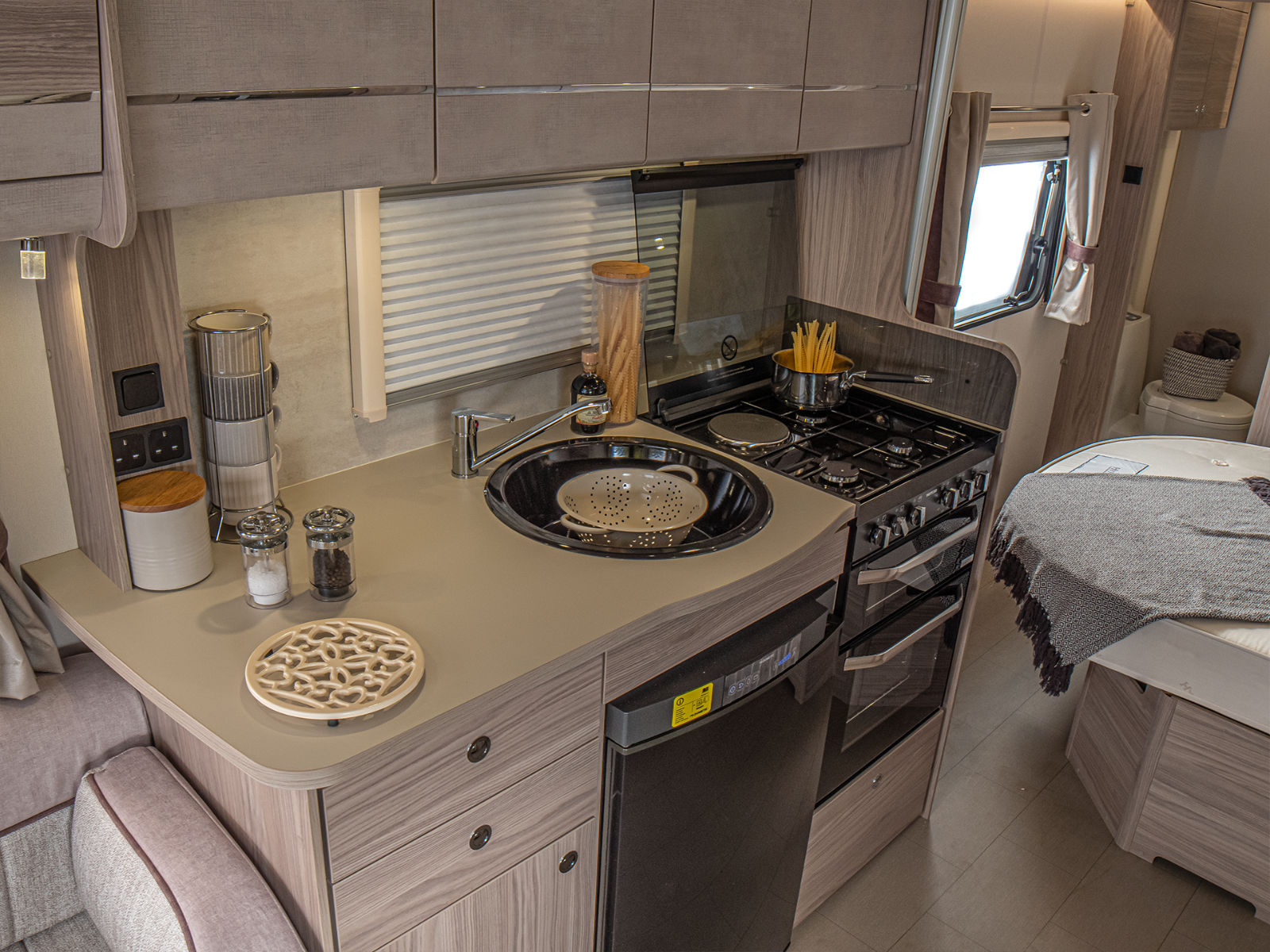 Osprey Caravan Kitchen area with sink, hob, oven and fridge-freezer '